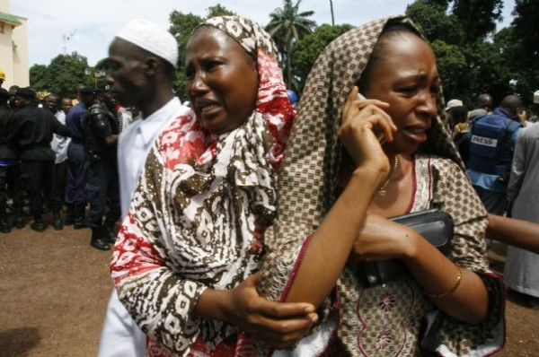 Sept. 28, 2009, two Guinean women try to find their relatives after massive attack by Guinea security services against opposition protesters..These women, as well as thousands of others, want justice which is long overdue..