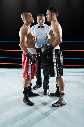 Referee and boxers face to face